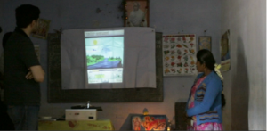 Frugal Digital team members test a lunchbox projector in a school in rural India.